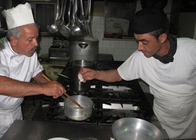 Chef Piero and his assistant Ernesto making sauce