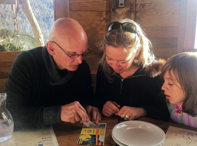 Milena and Tom study their lottery ticket.  If they win, they'll split 50-50.  It's a big one.  The numbers are drawn on Epiphany.  If Tom wins, he and Heidi will buy the apartment next door to us.