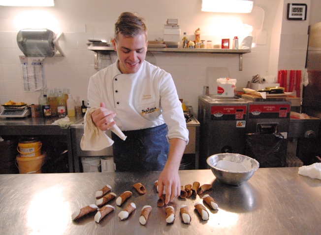 Signor Pietro mades cannoli downstairs in the kitchen.
