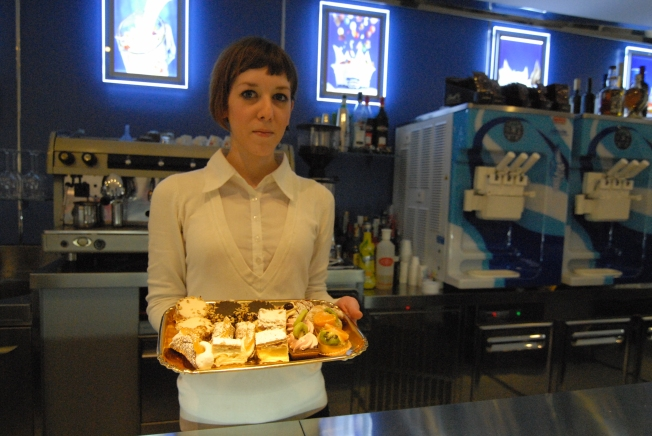 This is Anna who makes the coffee and explains the finer points between each pastry.