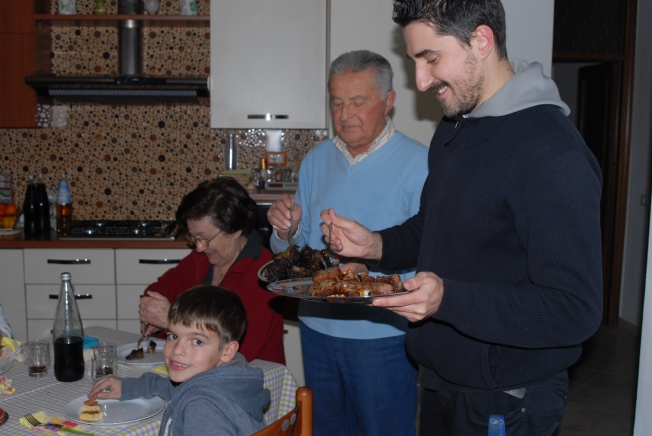 Luca and Giulio serve the meat.