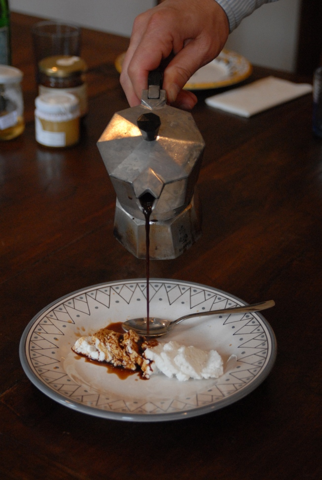 a pot of sweet coffee poured over a plate of ricotta