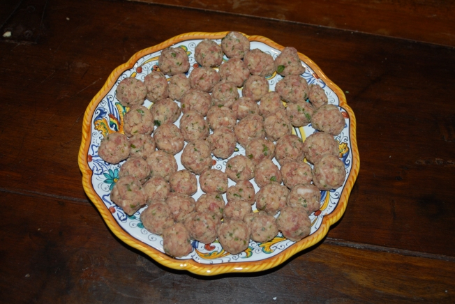 The meatballs are ready to add to the tomato sauce where they will cook before becoming one of the layers in the baked pasta