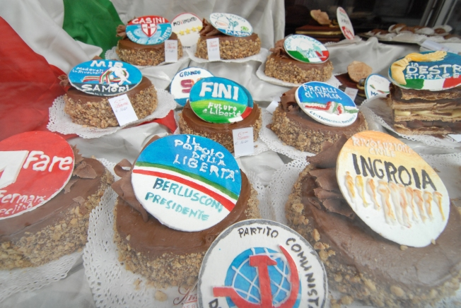 A window display at Sandri Cafe on Corso Vanucci: Their famous desserts covered with a sugar design of the major political party insignias.  All of them equally delicious.