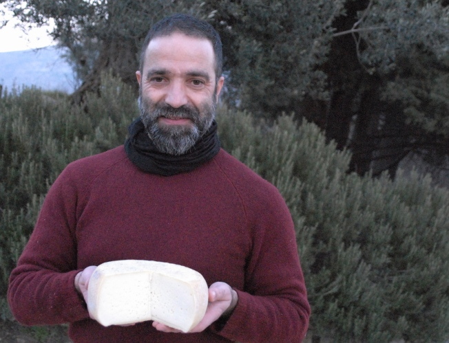 Signor Marco with a wheel of pecorino cheese