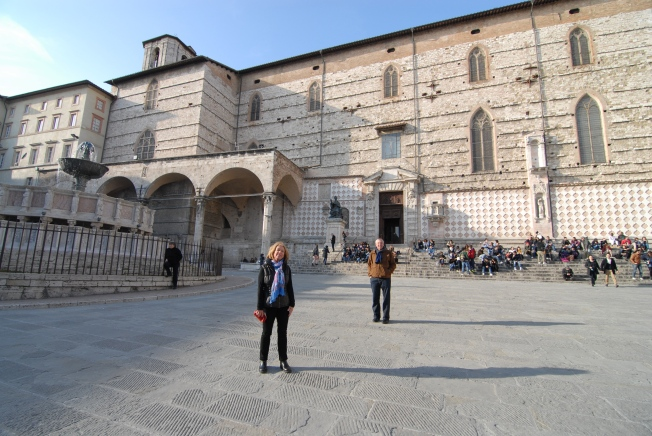 My parents in Piazza IV Novembre.  Behind is the city's biggest fountain and the Cathedral of San Lorenzo.