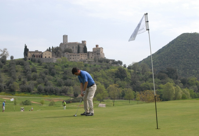 On the putting green with some crazy beautiful medieval castle in the background.  Matt's best score ever at Antognolla is a 94.