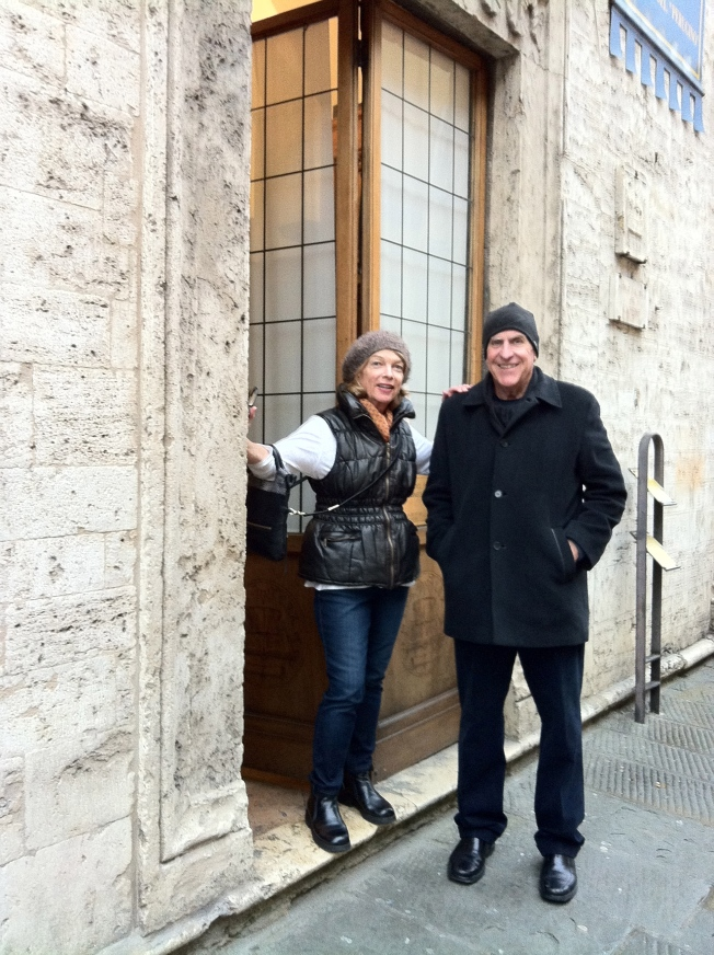 Mom and Dad outside the doors of the Collegio di Cambio.  No photos allowed inside.