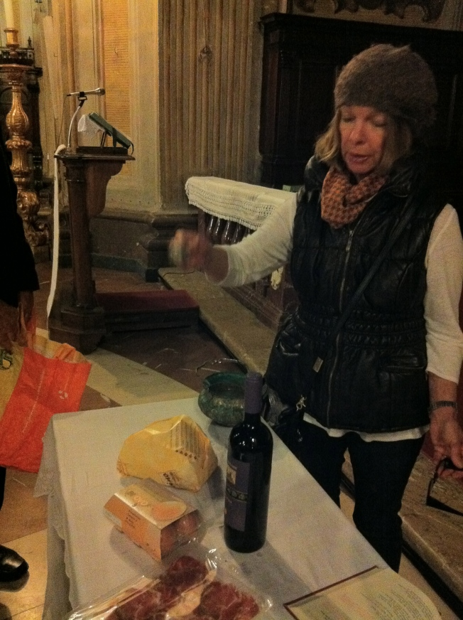 Here's my mom with priest tools giving our cheese bread a proper hallelujah