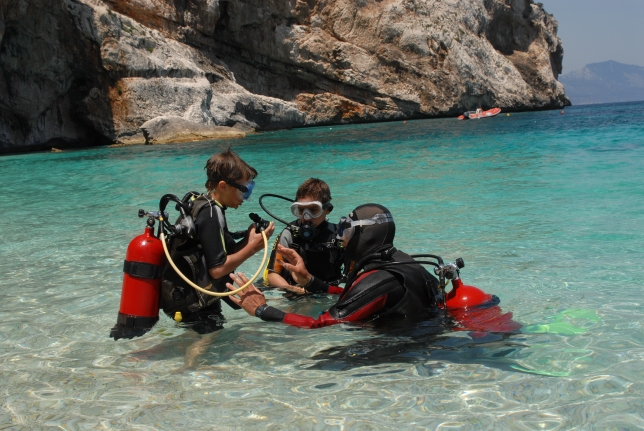 While we were playing on the beach at Cala M, someone offered to take the boys on a mini scuba diving adventure.  They put on all the equipment and went for a short and shallow dive.
